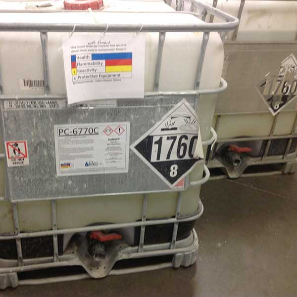 hazardous chemical container with labels